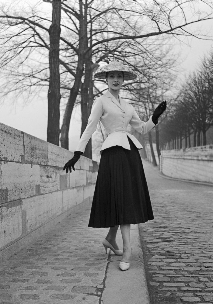 Christian Dior, Paris (fashion house); Christian Dior (designer) Bar, afternoon ensemble spring−summer 1947 collection, modelled by Renée 1955. Dior Heritage collection, Paris © Willy Maywald/ADAGP, Paris. Licensed by Viscopy, Sydney