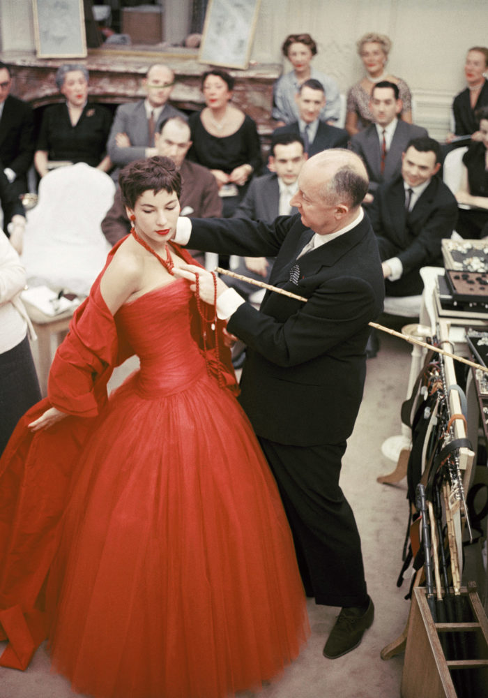 "Christian Dior with fashion model Victoire wearing the ""Zaire"" dress (Autumn-Winter Haute Couture collection, H line) 1954 © 2013 Mark Shaw"